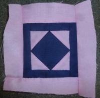 Block C-1 of the Dear Jane sampler quilt named 'trooper Green's badge'.