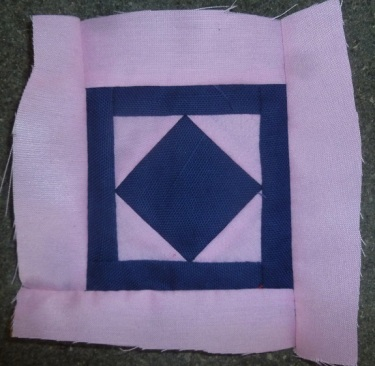 Block C-1 of the Dear Jane sampler quilt named 'trooper Green's badge'.