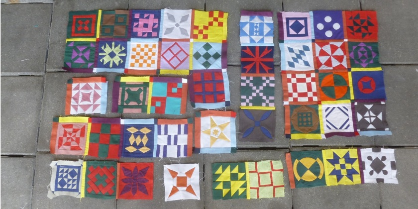 Some finished Dear Jane blocks together