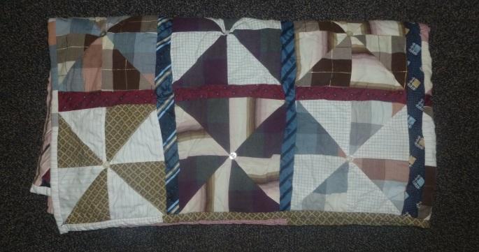 Folded finished pinwheel quilt