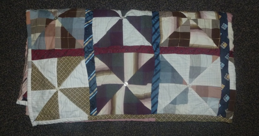Folded finished pinwheel quilt