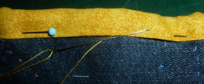 Sewing the border of a quilt down